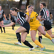 11/3/165:33:47 PM --- Soccer Match Long Beach against CSUN-<br /> CSUN defender Christina Nixon (6) fighting for the ball with Long Beach State defender  Allie Emmons (12)<br /> <br /> Photo By Leandro Bernardes, Sport Shooter Academy