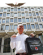 CND and Stop The War Rally outside the US Embassy, London, Great Britain <br /> 11th August 2017 <br /> <br /> An actor dressed as Donald Trump holds a bag with the slogan I'm Ready to Press The Button outside the US Embassy in London <br /> <br /> Delegation calls for end to nuclear brinkmanship<br /> <br /> A delegation of journalists, writers, playwrights and anti-war activists will visit the US Embassy today to deliver a letter to the US ambassador to Britain. The letter calls on Donald Trump to desist from inflammatory statements and behaviour which is taking us to the brink of nuclear war.  <br /> <br /> Members of the delegation believe that Donald Trump's recent comments - threatening North Korea with &quot;fire and fury like the world has never seen&quot; - have significantly increased the risk of outright military conflict. War with North Korea is now a real possibility unless a very different approach is adopted by Britain's main ally.<br /> <br /> <br /> Photograph by Elliott Franks <br /> Image licensed to Elliott Franks Photography Services