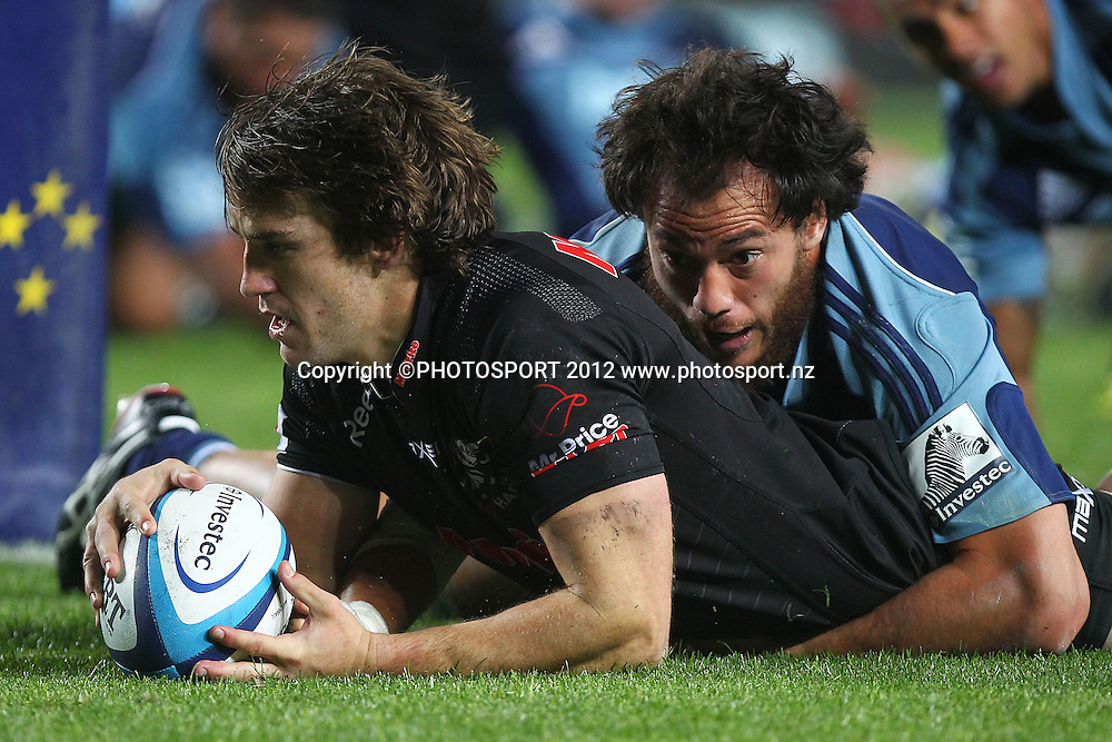 Sharks' Keegan Daniel scores a try against Blues' Chris Lowrey. Super Rugby rugby union match, Blues v Sharks at Eden Park, Auckland, New Zealand. Friday 13th April 2012. Photo: Anthony Au-Yeung / photosport.co.nz
