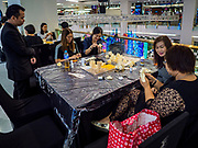 "24 MAY 2017 - BANGKOK, THAILAND: Volunteers at the Emporium, an upscale shopping mall in Bangkok, make wooden roses to be used during the cremation of Bhumibol Adulyadej, the Late King of Thailand. In Thai culture it is customary to place wooden flowers in front of a deceased person's coffin or urn as a last tribute before cremation. The Royal Cremation Organisation Committee, which is overseeing plans for the cremation of Bhumibol Adulyadej, the Late King of Thailand, asked the Bangkok Metropolitan Administration (BMA) to provide three million wooden flowers for the late King's cremation. The BMA, in turn, has asked malls and civic organizations to provide flowers. The Mall Group, which owns Emporium, has pledged to provide up to one million wooden ""Wiangping"" roses, which in Thai culture symbolize unconditional love. The late King will be cremated October 26, 2017.     PHOTO BY JACK KURTZ"