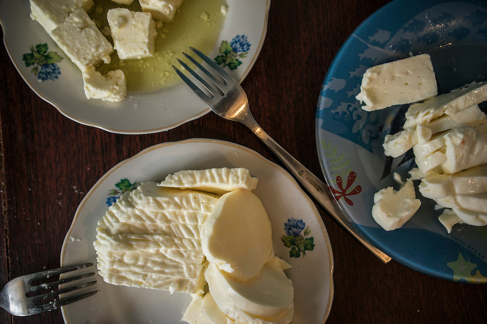 Samples of home-made cheese prepared by Olga Anisimova, 33, who fled from Yalta on the Crimean peninsula, on Tuesday, April 28, 2015 in Dubliany, Ukraine. The Russian takeover of Crimea forced Anisimova and her family to flee to the suburb of Lviv, where she has started a business selling home-made fresh cheese, though her hope is to move to Slovakia. CREDIT: Brendan Hoffman/Prime for the Wall Street Journal UKRMIGRATION