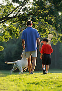 NJ, Morris County, Father and son with dog.