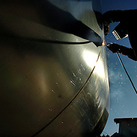 Wednesday, 8:15 A.M. Water Tank Fabricator, Michael Olson welds the sides of a new 11,400 gallon tank at Osborne Tank and Supply on National Trails Highway in Oro Grande. Eric Reed/Staff photographer