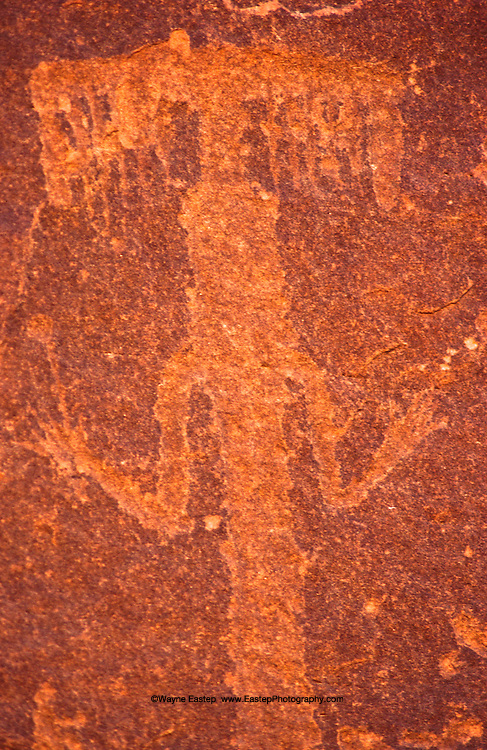 Incised style rock art representing a human dancing. Hanakiyyah, Saudi Arabia