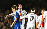 Basel's Marco Streller and team mate Behrang Safari celebrate alongside Chelsea's Oscar during their UEFA Champions League group match at Stamford Bridge in London, 27 August 2013.  BOGDAN MARAN / BPA