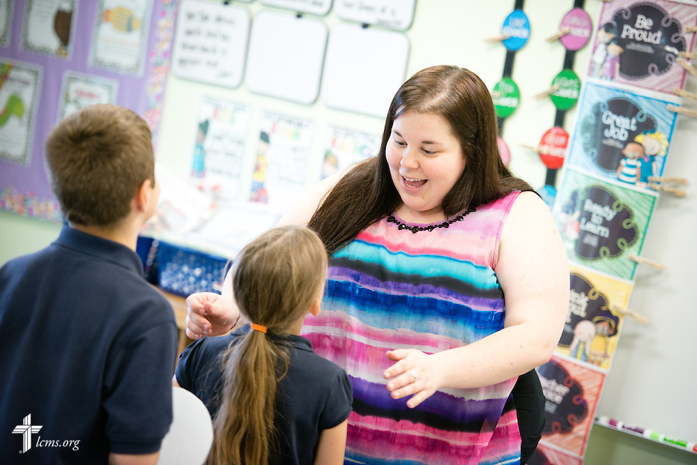 Teacher Jennifer Brown helps students with an activity in her second grade class at the Renaissance School, part of Lutheran Urban Mission Initiative, Inc., on Wednesday, May 20, 2015, in Mt. Pleasant, Wis. LCMS Communications/Erik M. Lunsford
