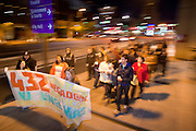 22 DECEMBER 2011 - PHOENIX, AZ:   Marchers walk through downtown Phoenix. About 300 people marched through downtown Phoenix Thursday night in a silent candle lit procession to protest against the way the Maricopa County Sheriff's Department, led by Sheriff Joe Arpaio, has conducted sexual assault and rape investigations. Two recent media reports, one by the East Valley Tribune, a newspaper in Mesa, AZ, and one by the Associated Press concluded that the Sheriff's department has bungled more than 430 rape investigations. Last week, a US Department of Justice report cited the unresolved rape investigations along with evidence of wide spread racial profiling by the sheriff's department in a report that was highly critical of Sheriff Arpaio and the Sheriff's Department.    PHOTO BY JACK KURTZ
