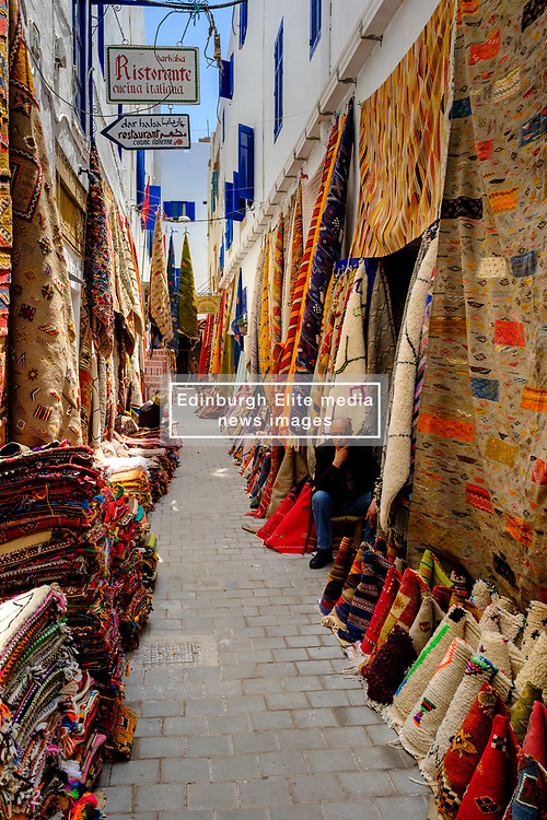 Stalls selling carpets and rugs in the narrow streets of the medina, Essaouira, Morocco<br /> <br /> (c) Andrew Wilson   Edinburgh Elite media