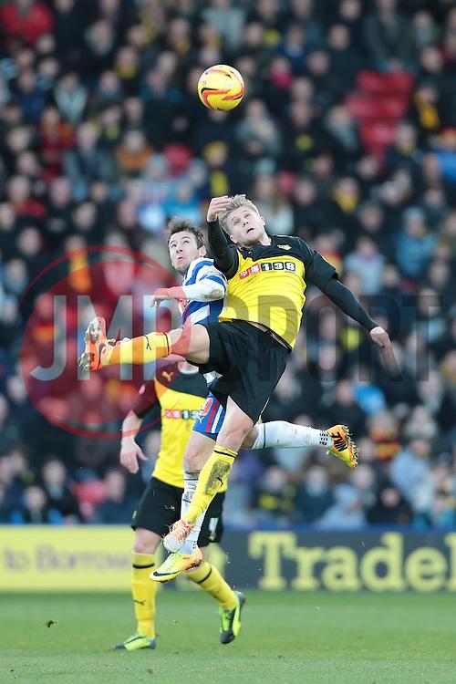 Reading's Adam Le Fondre and Watford's Alexander Merkel challenge for the ball - Photo mandatory by-line: Nigel Pitts-Drake/JMP - Tel: Mobile: 07966 386802 11/01/2014 - SPORT - FOOTBALL - Vicarage Road - Watford - Watford v Reading - Sky Bet Championship