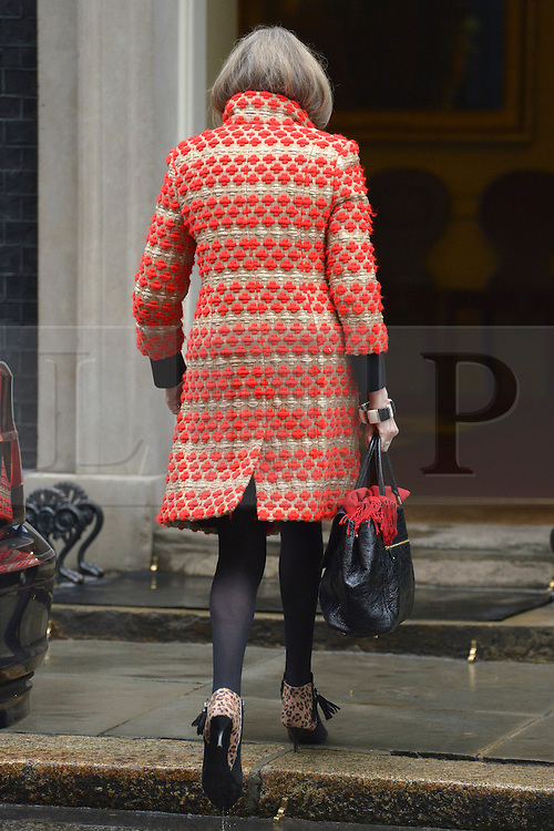 © Licensed to London News Pictures. 20/03/2013. Westminster, UK. Theresa May, Conservative MP, Secretary of State for the Home Department and Minister for Women and Equalities,..Chancellor Of The Exchequer George Osborne poses for photographers whilst holding his red ministerial box outside 11 Downing Street In London, before presenting his annual budget to parliament today 20th March 2013. Photo credit : Stephen Simpson/LNP