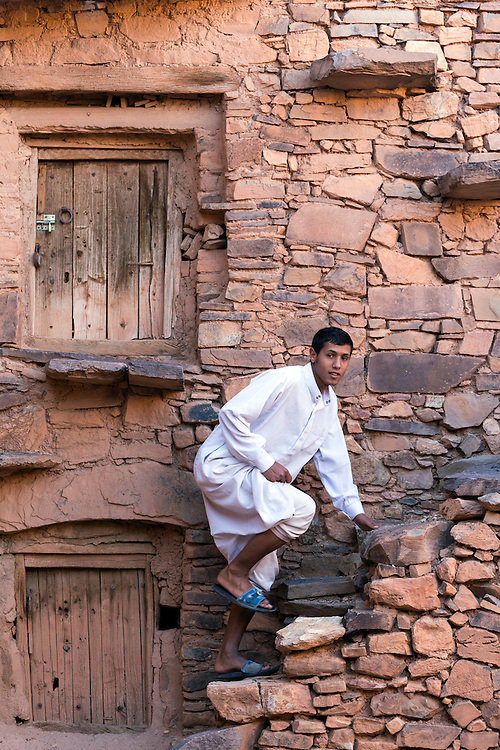TAGADIRT, MOROCCO - MAY 26TH 2016 - A local climbs the stone steps at the Tagadirt Granary (Agadir Tagadirt), Ighrem and Tafraoute province of the Souss Massa Draa, Southern Morocco.