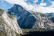 Cliff walls tower above the valley floor in Yosemite National Park, California.
