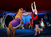 """Zeus"" and Sara Greene perform in the center ring with Gigi Greene, ""Rosie"" the dog and Haley Warren in the Granite State Circus at Weirs Beach.  (Karen Bobotas/for the Laconia Daily Sun)"