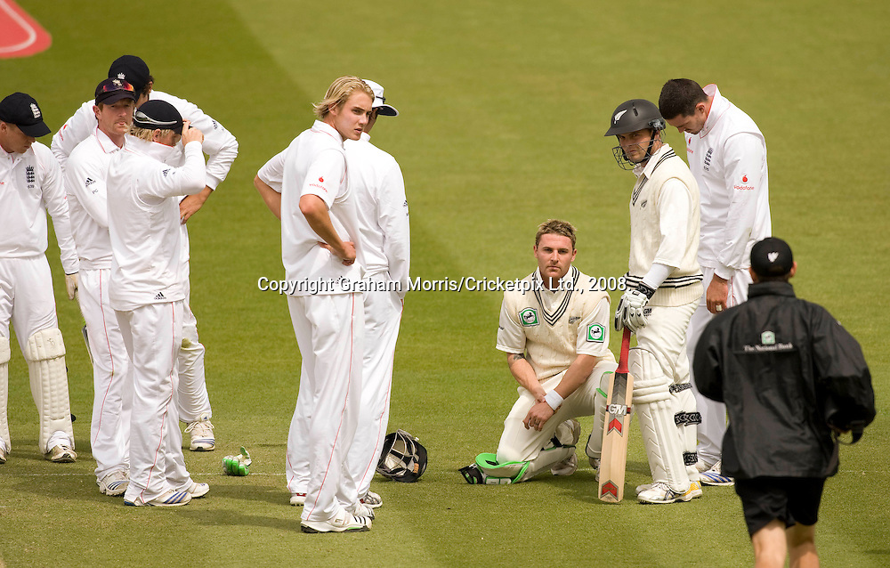 Brendon McCullum is struck on the arm by Stuart Broad and retires hurt during the first npower Test Match between England and New Zealand at Lord's. Photograph © Graham Morris/cricketpix.com (Tel: +44 (0)20 8969 4192; Email: sales@cricketpix.com)