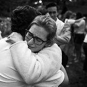 Musical theater majors embrace at the conclusion of Les Preludes on the last day of camp at interlochen Center for the Arts in interlochen, Michigan.