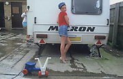 A Doherty sister posing outside a caravan, Winterbourne Travellers site, Bristol, October 2002