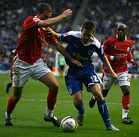 Photo: Steve Bond.<br /> Leicester City v Barnsley. Coca Cola Championship. 27/10/2007.  Matty Fryatt (C) tries to hold off Stephen Foster (L)