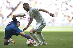 October 20, 2018 - Madrid, Madrid, Spain - Karim Benzema of Real Madrid fight the ball with Postigo of Levante during a match for the Spanish League between Real Madrid and Levante at Santiago Bernabeu Stadium on October 20, 2018 in Madrid, Spain. (Credit Image: © Patricio Realpe/NurPhoto via ZUMA Press)