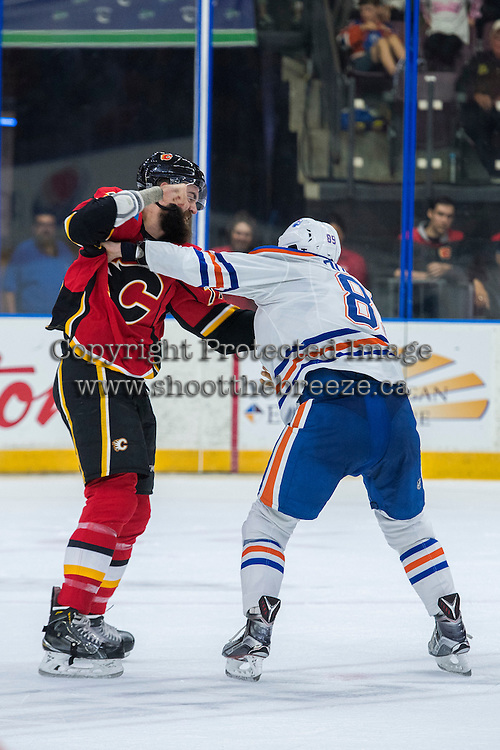 PENTICTON, CANADA - SEPTEMBER 17: Matt Benning #83 of Edmonton Oilers drops the gloves with Hunter Smith #71 of Calgary Flames on September 17, 2016 at the South Okanagan Event Centre in Penticton, British Columbia, Canada.  (Photo by Marissa Baecker/Shoot the Breeze)  *** Local Caption *** Matt Benning; Hunter Smith;