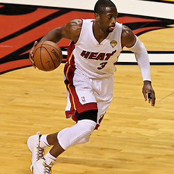 Jun 21, 2012; Miami, FL, USA; Miami Heat shooting guard Dwyane Wade (3) against the Oklahoma City Thunder during the first quarter in game five in the 2012 NBA Finals at the American Airlines Arena. Mandatory Credit: Derick E. Hingle-US PRESSWIRE
