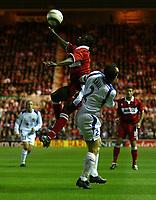 Photo. Andrew Unwin.<br /> Middlesbrough v Banik Ostrava, UEFA Cup, First Round, First Leg, Riverside Stadium, Middlesbrough 16/09/2004.<br /> Middlesbrough's George Boateng (L) outjumps Banik Ostrava's Radek Latal (R)<br /> NORWAY ONLY