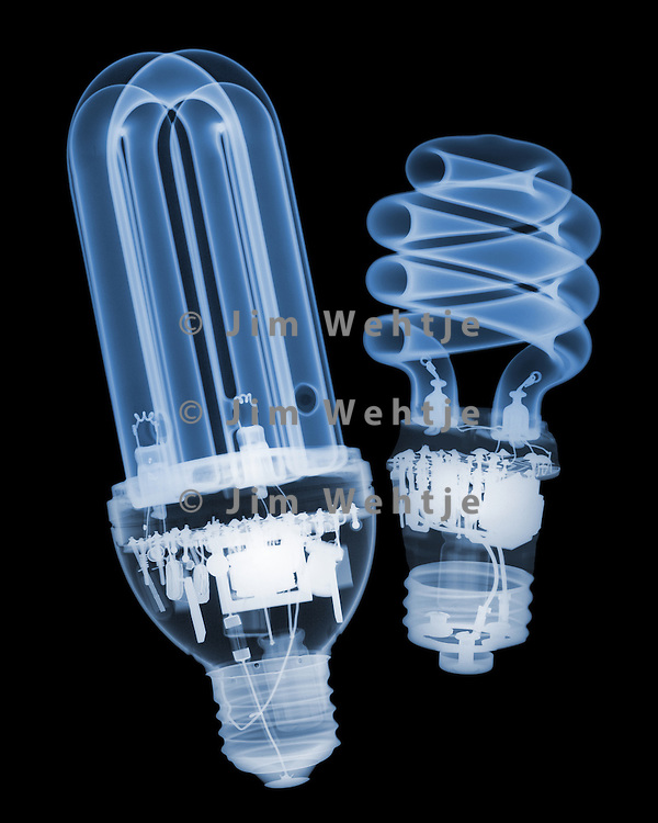 X-ray image of two compact fluorescent lamps (blue on black) by Jim Wehtje, specialist in x-ray art and design images.