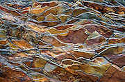 "Billion-year-old rock breaks into a jagged pattern in Glacier National Park, Montana. Published in ""Light Travel: Photography on the Go"" book by Tom Dempsey 2009, 2010. Since 1932, Canada and USA have shared Waterton-Glacier International Peace Park, which UNESCO declared a World Heritage Site (1995) containing two Biosphere Reserves (1976). Rocks in the park are primarily sedimentary layers deposited in shallow seas over 1.6 billion to 800 million years ago. During the tectonic formation of the Rocky Mountains 170 million years ago, the Lewis Overthrust displaced these old rocks over newer Cretaceous age rocks."