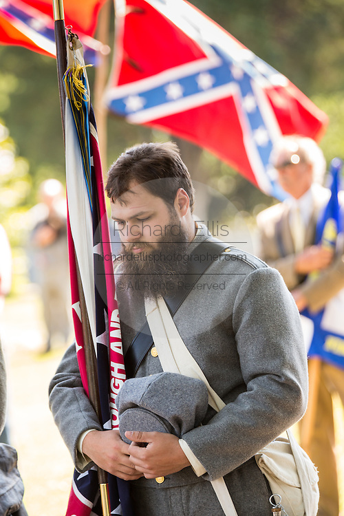 Civil war re-enactors in period costume stand for a moment of silence during a service at Elmwood Cemetery to mark Confederate Memorial Day May 2, 2015 in Columbia, SC. Confederate Memorial Day is a official state holiday in South Carolina and honors those that served during the Civil War.