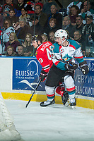 KELOWNA, CANADA - APRIL 8: Skyler McKenzie #43 of the Portland Winterhawks is checked at the boards by Cal Foote #25 of the Kelowna Rockets on April 8, 2017 at Prospera Place in Kelowna, British Columbia, Canada.  (Photo by Marissa Baecker/Shoot the Breeze)  *** Local Caption ***