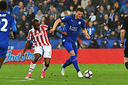 Leicester City defender Robert Huth (6) battles with Stoke City striker Saido Berahino (9) during the Premier League match between Leicester City and Stoke City at the King Power Stadium, Leicester, England on 1 April 2017. Photo by Jon Hobley.
