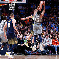 05 April 2018: Minnesota Timberwolves center Karl-Anthony Towns (32) jumps for the rebound with Denver Nuggets center Mason Plumlee (24) during the Denver Nuggets 100-96 victory over the Minnesota Timberwolves, at the Pepsi Center, Denver, Colorado, USA.
