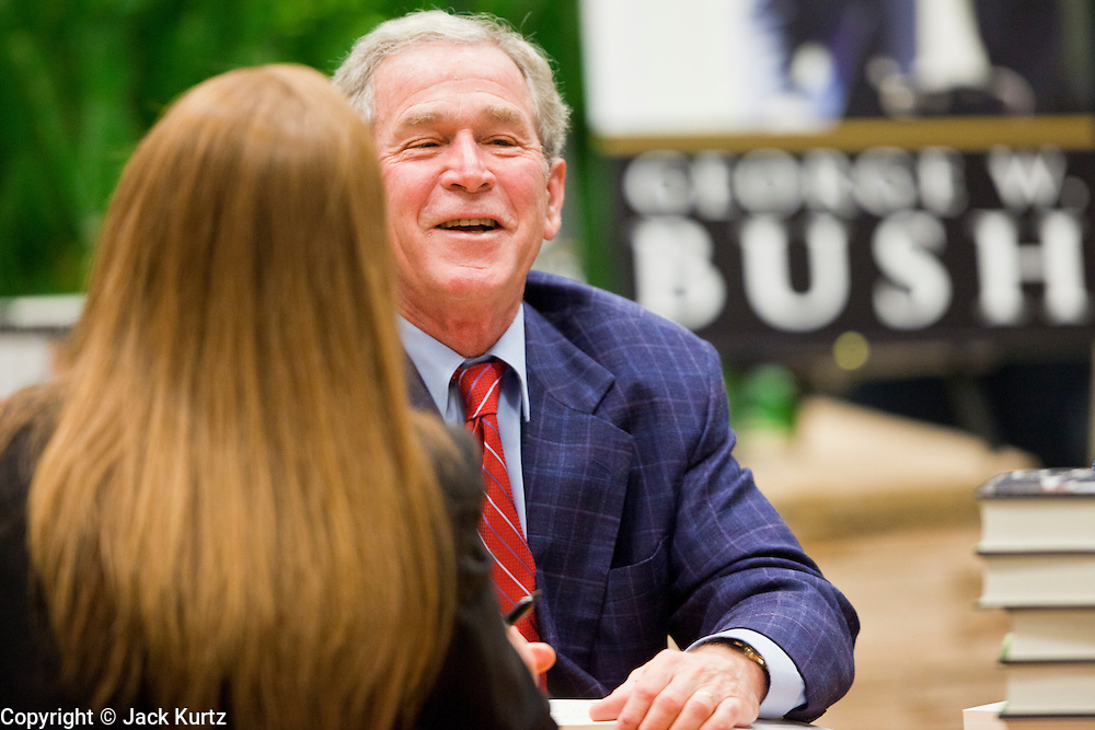 "09 DECEMBER 2010 - PHOENIX, AZ:  Former President GEORGE W. BUSH greets people and signs copies of his book, ""Decision Points"" at the Barnes & Noble Bookstore in Phoenix, AZ, Thursday, Dec. 9. More than 2,000 people lined up starting at 5AM to get copies of the former President's book, ""Decision Points."" A handful of protesters demonstrated against President Bush near the bookstore, calling him a ""war criminal."" PHOTO BY JACK KURTZ"