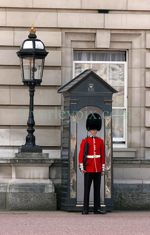 21 April 2010. London, England..A Royal Foot Guard, a member of the Scots Guards stands at sentry duty at  Buckingham Palace in the run up to Catherine Middleton's marriage to Prince William..Photo; Charlie Varley.