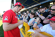 Jan 24, 2018; Kissimmee, FL, USA; Oakland Raiders quarterback Derek Carr (4) happily signs autographs for fans after practice for the 2018 Pro Bowl at ESPN Wide World of Sports Complex. (Steve Jacobson/Image of Sport)