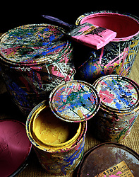 Abstract design splattered paint cans. multi color colour colorful yellow red blue green purple streaks blotches splotches