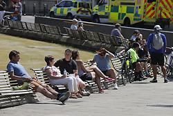 © Licensed to London News Pictures. 30/05/2020. Windsor, UK. Visitors to Windsor enjoy the sunshine outside the Castle as the temperatures rise. The government have announced new measures from Monday to allow groups of six people to meet outdoors. Photo credit: Peter Macdiarmid/LNP