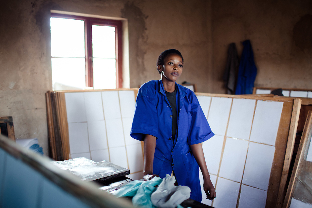 Sophie Gahongayire, 26, a worker in a paper factory, Kigali, Rwanda. Both Sophie's parents were killed during the 1994 genocide when she was 9 years old. Her brother became a soldier, forcing her to become the head of the family.