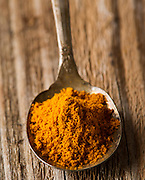 Turmeric, or other spice, displayed as a portion in a spoon