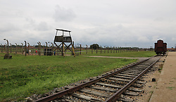 A Deutsche Reichsbahn 'Gueterwagen' (goods wagon), one type of rail car used for deportations, next to a guard tower, at the Auschwitz-Birkenau Nazi concentration camps in Auschwitz, Poland on September 3, 2017. Auschwitz concentration camp was a network of German Nazi concentration camps and extermination camps built and operated by the Third Reich in Polish areas annexed by Nazi Germany during WWII. It consisted of Auschwitz I (the original camp), Auschwitz II–Birkenau (a combination concentration/extermination camp), Auschwitz II–Monowitz (a labor camp to staff an IG Farben factory), and 45 satellite camps. In September 1941, Auschwitz II–Birkenau went on to become a major site of the Nazi Final Solution to the Jewish Question. From early 1942 until late 1944, transport trains delivered Jews to the camp's gas chambers from all over German-occupied Europe, where they were killed en masse with the pesticide Zyklon B. An estimated 1.3 million people were sent to the camp, of whom at least 1.1 million died. Around 90 percent of those killed were Jewish; approximately 1 in 6 Jews killed in the Holocaust died at the camp. Others deported to Auschwitz included 150,000 Poles, 23,000 Romani and Sinti, 15,000 Soviet prisoners of war, 400 Jehovah's Witnesses, and tens of thousands of others of diverse nationalities, including an unknown number of homosexuals. Many of those not killed in the gas chambers died of starvation, forced labor, infectious diseases, individual executions, and medical experiments. In 1947, Poland founded a museum on the site of Auschwitz I and II, and in 1979, it was named a UNESCO World Heritage Site. Photo by Somer/ABACAPRESS.COM