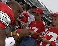 Sophomore Ted Ginn Jr. signs his autograph.