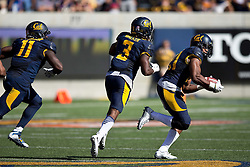 BERKELEY, CA - OCTOBER 03:  Safety Stefan McClure #21 of the California Golden Bears returns a fumble for a touchdown against the Washington State Cougars of the California Golden Bears during the third quarter at California Memorial Stadium on October 3, 2015 in Berkeley, California. The California Golden Bears defeated the Washington State Cougars 34-28. (Photo by Jason O. Watson/Getty Images) *** Local Caption *** Stefan McClure