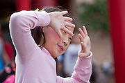 Feb. 8, 2009 -- PHOENIX, AZ: A girl performs a traditional Chinese dance at the Chinese Cultural Center in Phoenix, AZ. Chinese around the world celebrated the New Year this month. This is the Year of the Ox in the Chinese calender.  PHOTO BY JACK KURTZ