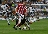 Photo: Steve Bond/Richard Lane Photography. Derby County v Sheffield United. Coca-Cola Championship. 13/09/2008. Kris Commons (front) goes down under a challange from Nick Montgomery