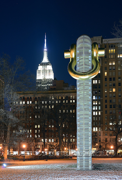 Madison Square Park art exhibition of American sculptor MARTIN PURYEAR at night.
