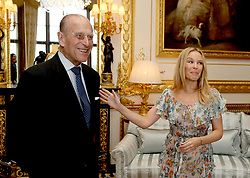 The Duke of Edinburgh, Patron of the Britain-Australia Society, presents Kylie Minogue with the Britain-Australia Society Award for 2016 during a private audience in the White Drawing Room at Windsor Castle, in Berkshire.