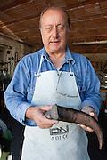 """Avigliano (PZ), 04-10-2010 ITALY - Vito Aquila, artigiano di Balestre. Il coltello di Avigliano, comunemente conosciuto come """"balestra"""", impreziosito con decorazioni in argento e ottone che le conferivano un certo valore non solo artistico,ha identificato per tutto l'Ottocento e parte del Novecento il carattere fiero e risoluto del popolo aviglianese, come attestato in una lunga casistica di riscontri documentari. La """"balestra"""" è un'arma a tutti gli effetti, ed è già considerata -nell'ambito delle manifatture di ferro - oggetto di pregio. Per l'approvvigionamento dell'argento e dell'ottone destinati alla decorazione del manico del coltello gli armieri si rivolgevano agli orefici o agli ottonari. La """"balestra"""" era un'arma del popolo, pronta ad essere impiegata, a seconda delle circostanze, per la difesa o l'offesa tanto dagli uomini quanto dalle donne. Queste, la ricevevano come regalo di fidanzamento dal rispettivo promesso sposo per meglio difendere il proprio onore, perpetrando un'usanza molto sentita almeno fino ai primi decenni del '900..Nella Foto: Corno di bufalo utilizzato per il manico della balestra.."""