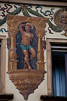 Detail of a frieze of St. Sebastian on a building facade in Lucerne, Switzerland.