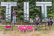 Boy Blue Entertainment appearing via Sadlers Wells pose with the Latitude sign and the famous pink sheep - The 2017 Latitude Festival, Henham Park. Suffolk 14 July 2017