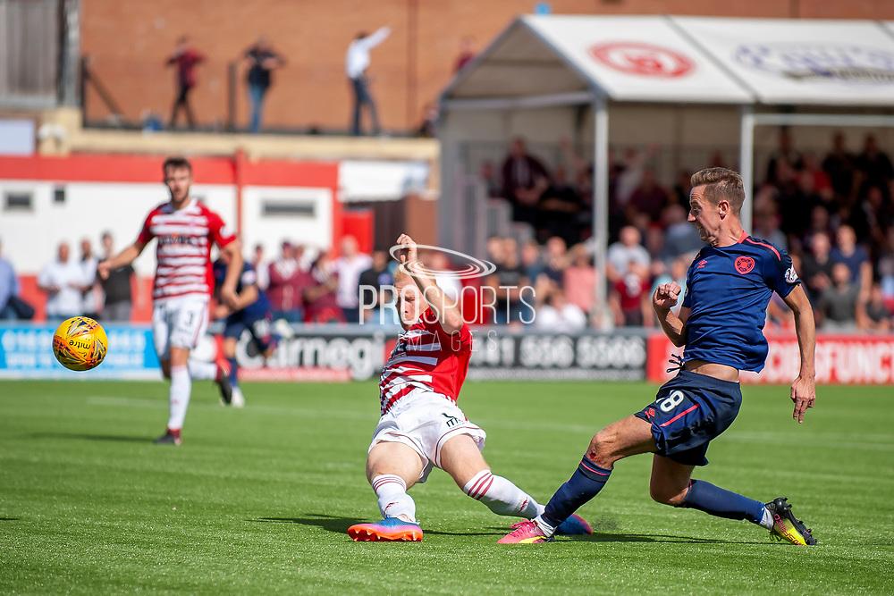 Steven MacLean of Heart of Midlothian scores Hearts third goal during the Ladbrokes Scottish Premiership League match between Hamilton Academical FC and Heart of Midlothian FC at New Douglas Park, Hamilton, Scotland on 4 August 2018. Picture by Malcolm Mackenzie.