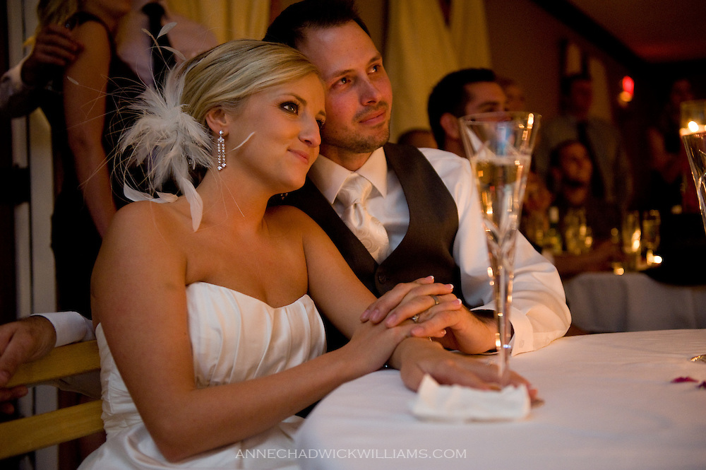 Bride and groom listen to toasts at Forest House Lodge in Foresthill, CA.